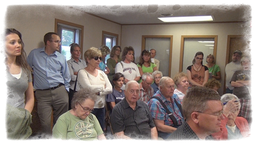 "Glenwood Area residents in western Wisconsin pack the house at the August 12, 2013 city council meeting. The overflow crowd presented a referendum petition urging the city council to allow people to be ""part of the process"" when considering frac sand mining issues in their community."