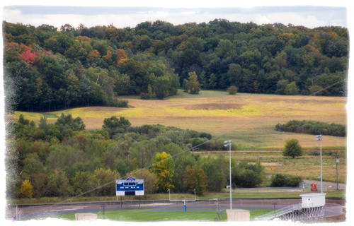 The tree covered hill at the sky line is the proposed 400 acre Vista Mine site less than 1/2 mile from the Glenwood City, WI public school. The football field and track areas, visible in the foreground, are approximately 1/4 mile from the proposed site.